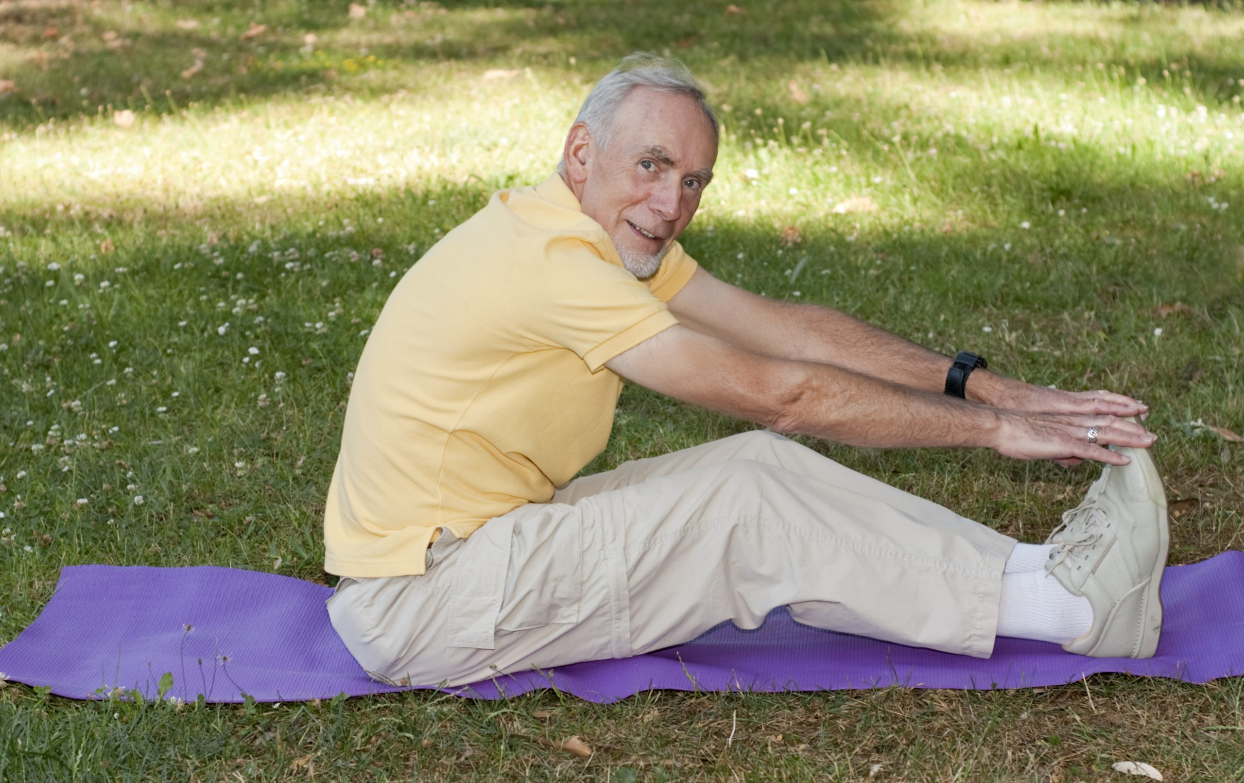 Gentleman with Prostate Cancer stretching in park
