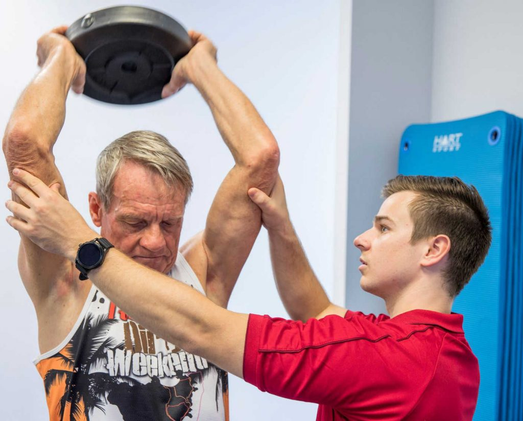 Exercise Physiologist teaching strength exercise